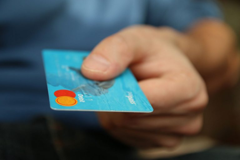 millennial consumer paying retailer with debit card