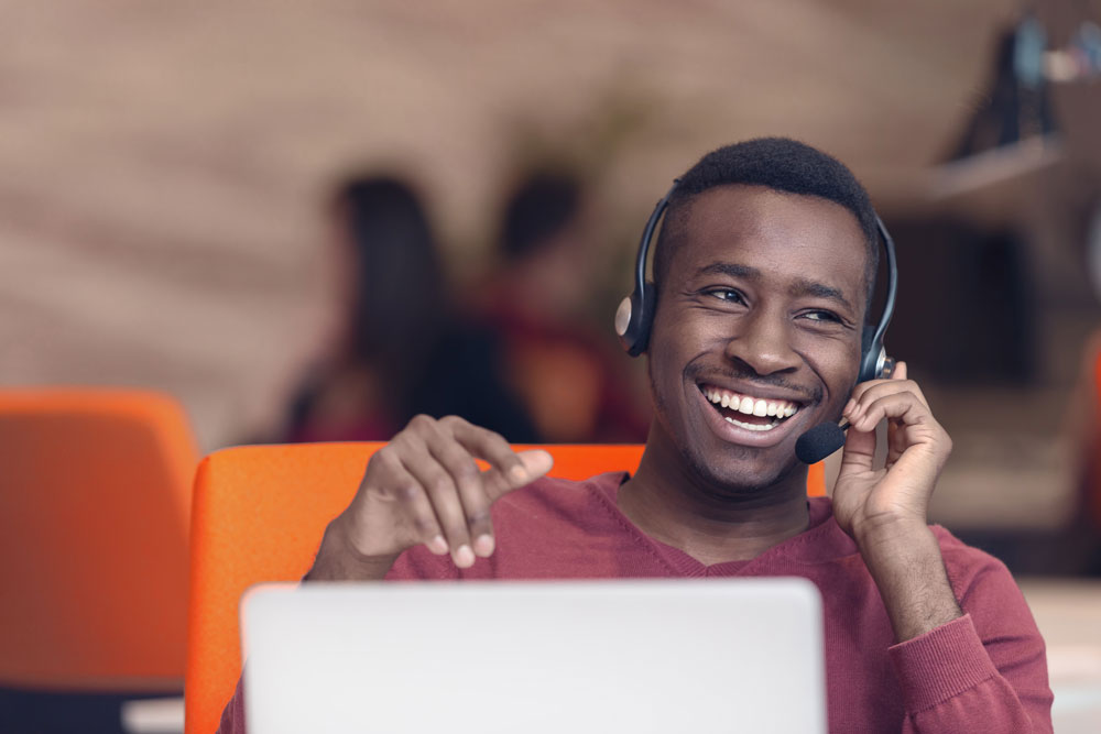 agent working in call center laughing