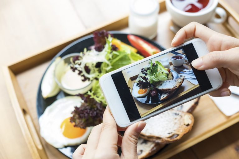 taking a photo of meal on smartphone