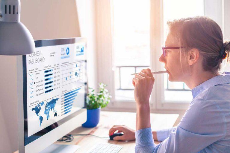woman analyzing data on computer