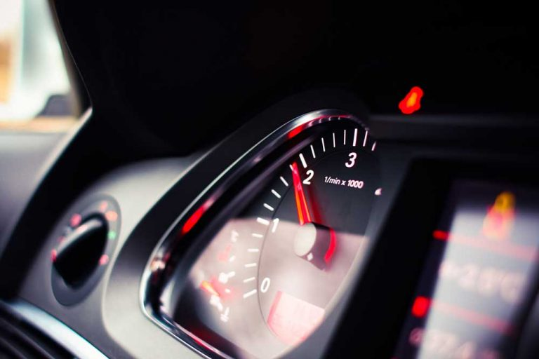 speedometer on car dashboard representing customer experience metrics giving key insights