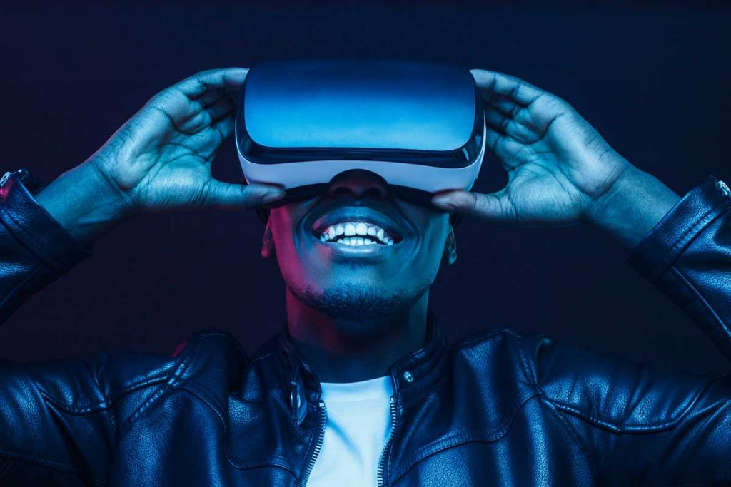 man using vr headset as example of customer experience trends in 2021